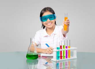 Little asian girl is making science experiments education